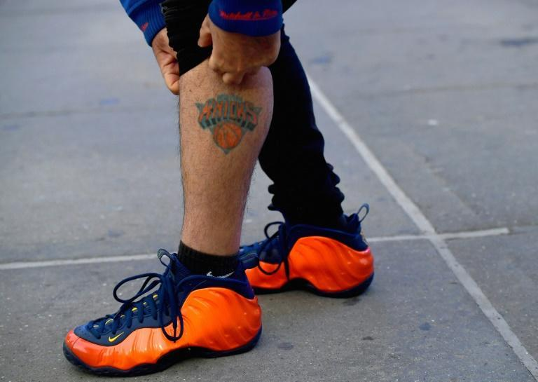 New York Knicks superfan Anthony Donahue shows his tattoo prior to the Knicks' game against Golden State Warriors at Madison Square Garden on February 23, 2021