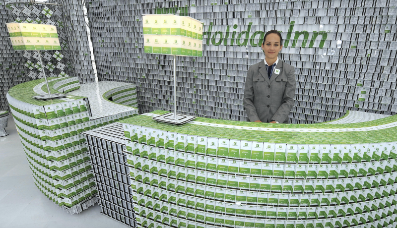 A Holiday Inn employee waits behind a front desk made of key cards as the first-ever key card hotel is unveiled September 17, 2009 in New York. (Photo: TIMOTHY A. CLARY/AFP/Getty Images)