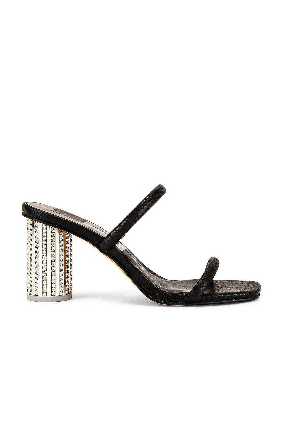 <p>Get sparkly with these <span>Dolce Vita Noles Disco Mules</span> ($135).</p>