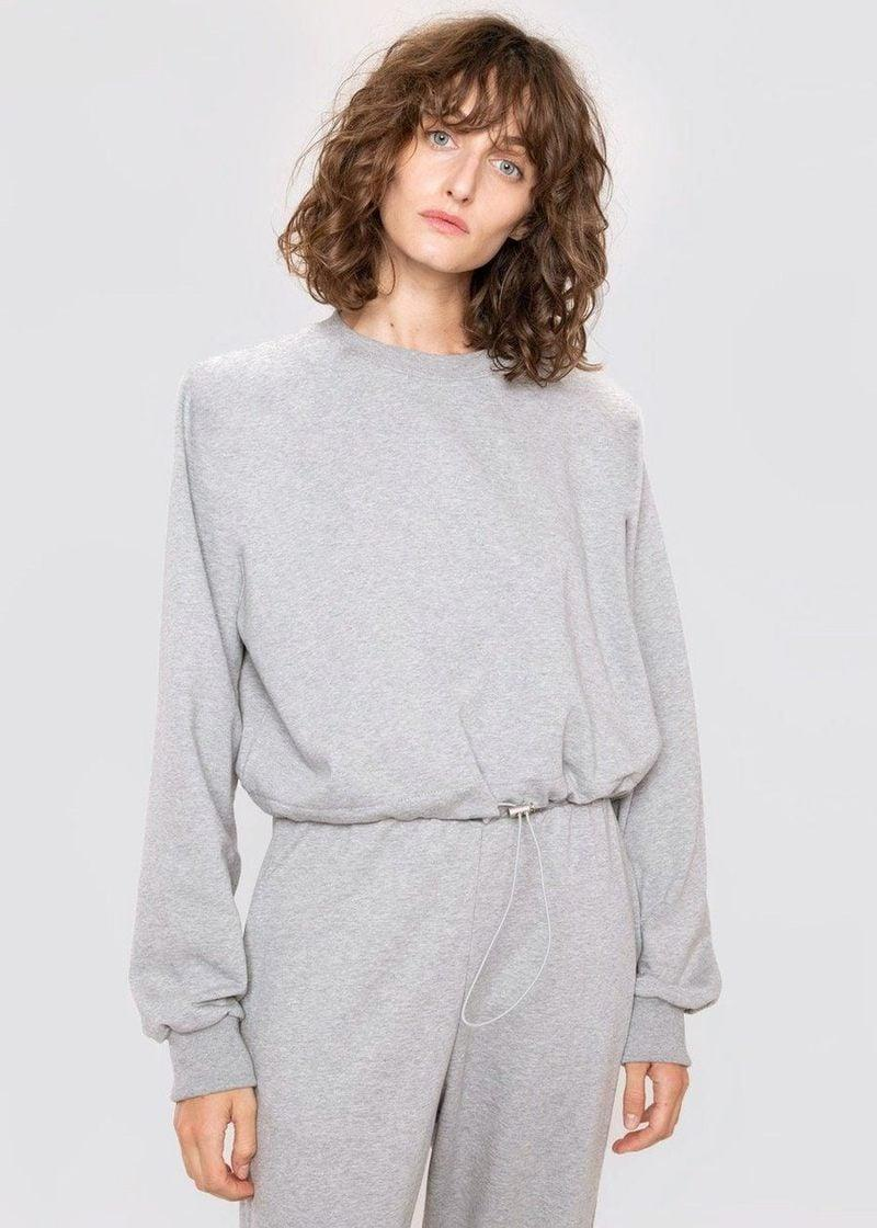 <p>The signature padded shoulder on <span>The Frankie Shop's Cinch Hem Shoulder Pad Sweatshirt</span> ($115) will instantly elevate any look.</p>