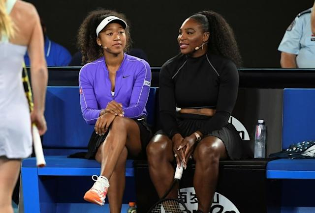 Naomi Osaka (left) and Serena Williams share a lighter moment in Melbourne Wednesday during the Rally for Relief event in support of the victims of the Australian bushfires (AFP Photo/WILLIAM WEST)