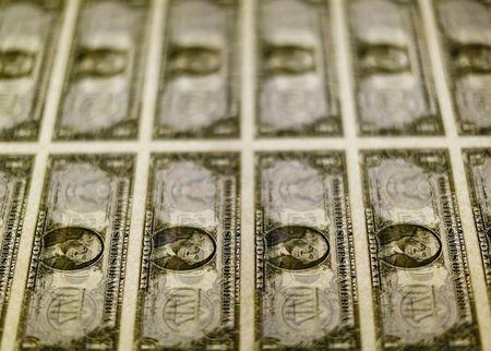 FILE PHOTO - United States one dollar bills seen on a light table at the Bureau of Engraving and Printing in Washington
