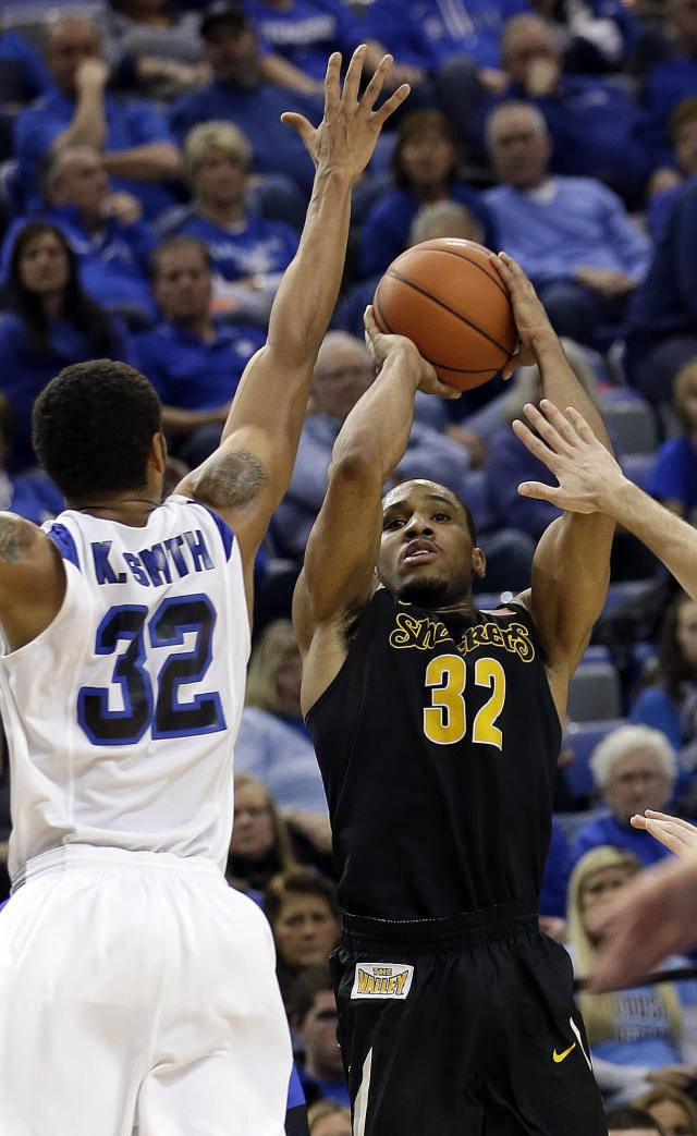 Wichita State guard Tekele Cotton, right, shoots in front of Indiana State's Khristian Smith during the first half of an NCAA college basketball game in Terre Haute, Ind., Wednesday, Feb. 5, 2014. Wichita State won 65-58. (AP Photo/AJ Mast)
