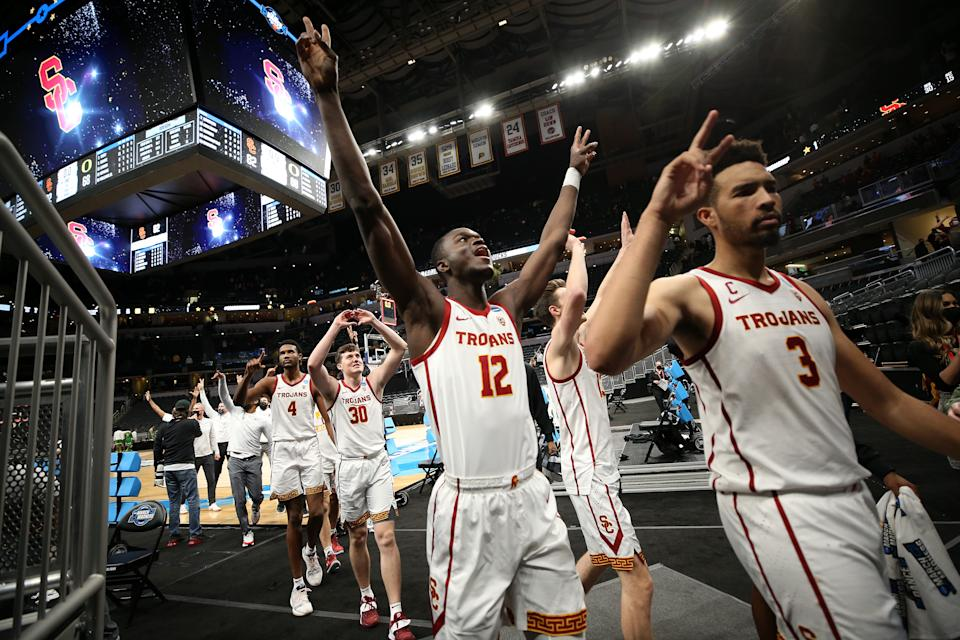 INDIANAPOLIS, INDIANA - MARCH 28: The USC Trojans celebrate after defeating the Oregon Ducks 82-68 in their Sweet Sixteen round game of the 2021 NCAA Men's Basketball Tournament at Bankers Life Fieldhouse on March 28, 2021 in Indianapolis, Indiana. (Photo by Jamie Squire/Getty Images)