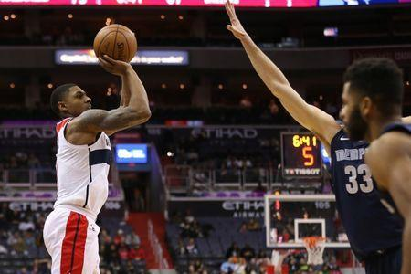 Dec 13, 2017; Washington, DC, USA; Washington Wizards guard Bradley Beal (3) shoots the ball over Memphis Grizzlies center Marc Gasol (33) in the fourth quarter at Capital One Arena. The Wizards won 93-87. Geoff Burke-USA TODAY Sports