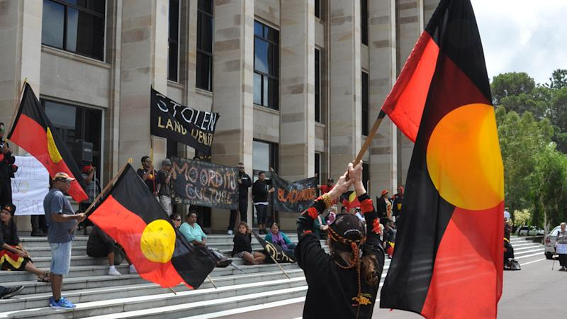 Aboriginal protesters have demonstrated outside the WA parliament against a native title deal.