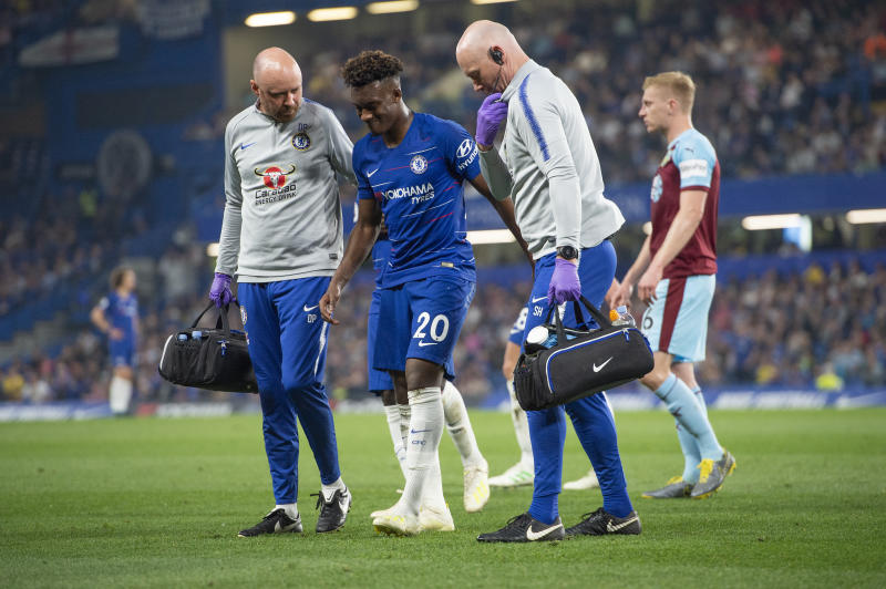 LONDON, ENGLAND - APRIL 22: Callum Hudson-Odoi of Chelsea is helped off the pitch by the Chelsea medical staff during the Premier League match between Chelsea FC and Burnley FC at Stamford Bridge on April 22, 2019 in London, United Kingdom. (Photo by Visionhaus/Getty Images)