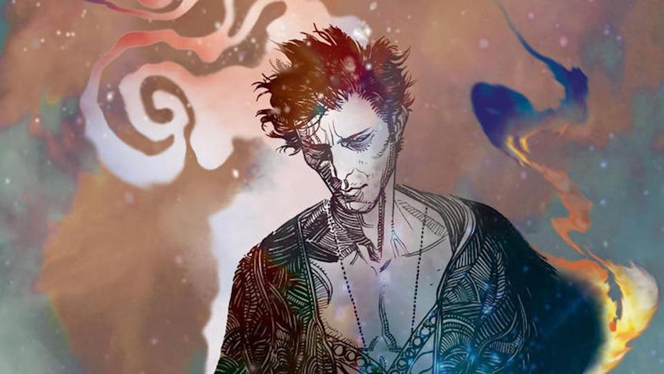 A swilring colorful background frames a melancholy Dream from The Sandman comic