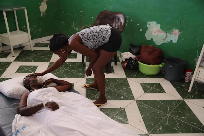 """Some of those injured during the earthquake are assisted in corridors or on floors of the general hospital due to the lack of available beds in Les Cayes on Aug. 16.<span class=""""copyright"""">Orlando Barría—EPA-EFE/Shutterstock</span>"""