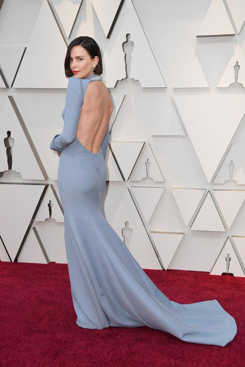 <p>The actress showed off a sexy back cutout in a Dior Haute Couture gown that hugged each and every single one of her curves.</p>