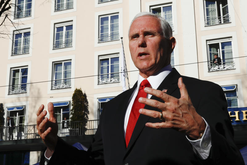 United States Vice President Mike Pence briefs the media during the Munich Security Conference in Munich, Germany, Saturday, Feb. 16, 2019. (AP Photo/Matthias Schrader)