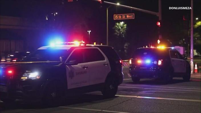 A woman died Friday after she was struck by a car while chasing after two men who might have robbed her in Lancaster, investigators said.