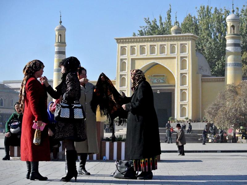 A group of Uighur women outside a mosque in Kashgar, farwest China's Xinjiang region, November 2013 (AFP/Getty Images)