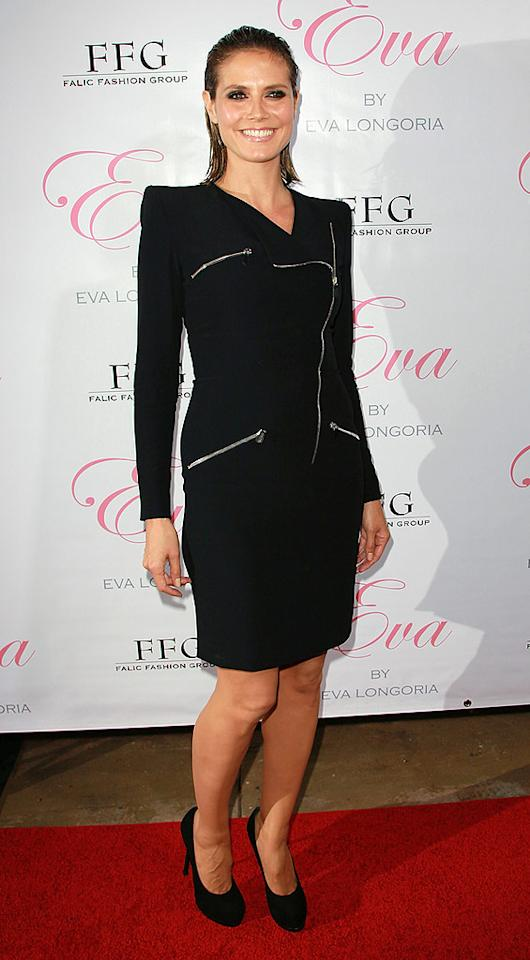 """Heidi Klum rarely gets it wrong on the red carpet, but the supermodel looked far from fabulous in an ill-fitting zippered frock and wet locks upon arriving at Eva Longoria's perfume launch party. David Livingston/<a href=""""http://www.gettyimages.com/"""" target=""""new"""">GettyImages.com</a> - April 27, 2010"""