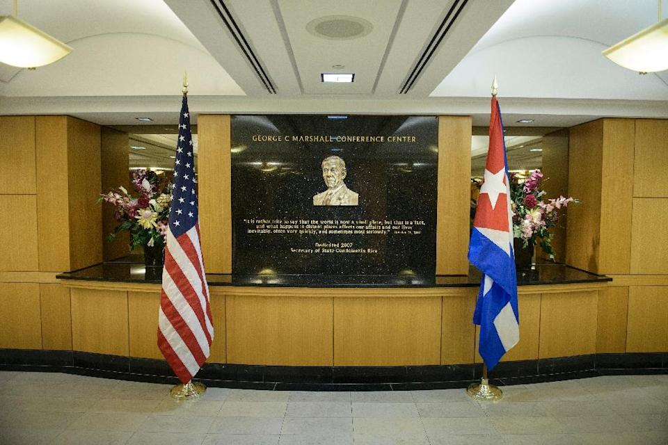 The US and Cuban flags are seen in the George C. Marshall Conference Center while representatives from the two nations meet at the US State Department on February 27, 2015 in Washington, DC (AFP Photo/Brendan Smialowski)