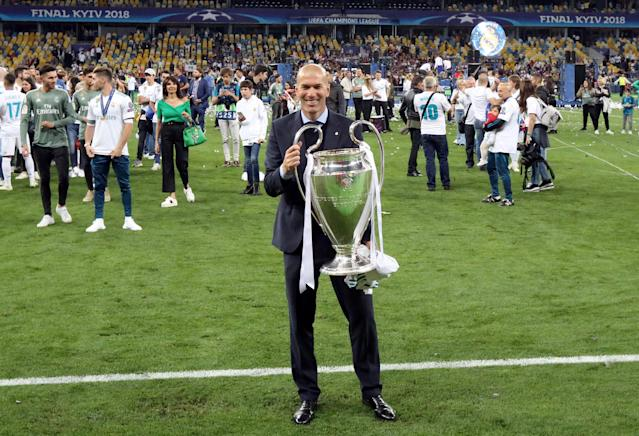Soccer Football - Champions League Final - Real Madrid v Liverpool - NSC Olympic Stadium, Kiev, Ukraine - May 26, 2018 Real Madrid coach Zinedine Zidane poses with the trophy as he celebrates after winning the Champions League REUTERS/Stringer