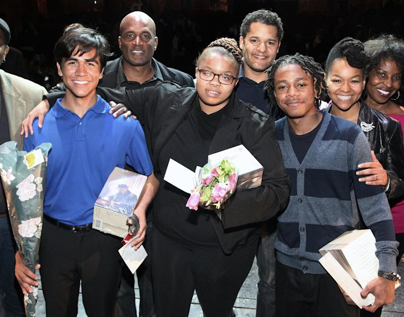 This May 6, 2013 photo shows, front row from left, second-place winner Pablo Lopez from Los Angeles, overall winner Tambi Gxuluwe from Pittsburgh and third-place winner Branndin Phillips-Laramore from Chicago, winners of the 5th Annual August Wilson Monologue Competition.    (AP Photo/The O+M Company, Gustavo Monroy)