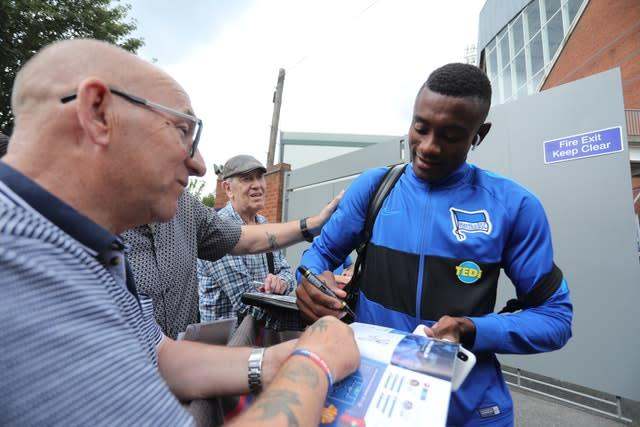 Kalou signs autographs ahead of a friendly against Crystal Palace (PA)