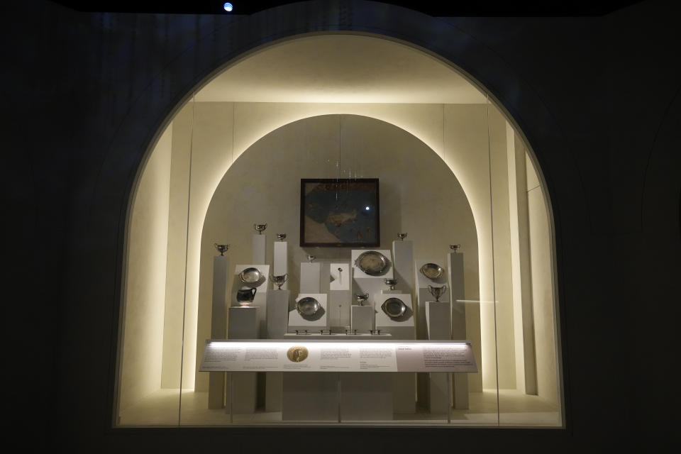 """Tableware items are displayed in an area to tell the story of Roman emperor Nero's grand palace, called the Domus Aurea (Golden House), which was unfinished by Nero's death in AD 68, during a media preview for the """"Nero: the man behind the myth"""" exhibition, at the British Museum in London, Monday, May 24, 2021. The exhibition, which open to visitors on May 27 and runs until October 24, explores the true story of Rome's fifth emperor informed by new research and archaeological evidence from the time. (AP Photo/Matt Dunham)"""