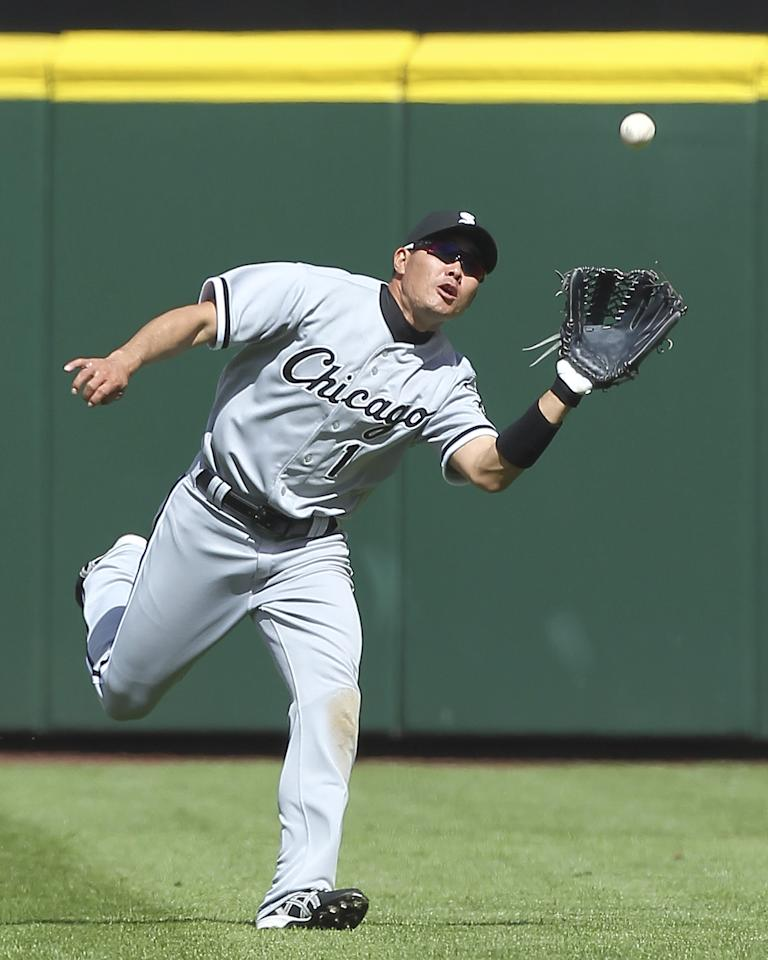 SEATTLE, WA - APRIL 22:  Center fielder Kosuke Fukudome #1 of the Chicago White Sox catches a fly ball by Miguel Olivo of the Seattle Mariners at Safeco Field on April 22, 2012 in Seattle, Washington. The White Sox defeated the Mariners 7-4. (Photo by Otto Greule Jr/Getty Images)