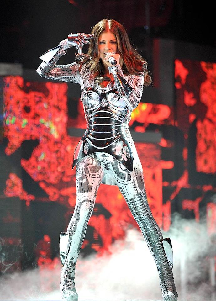 """You can always count on the Black Eyed Peas to rock interesting getups, although they occasionally can be hazardous to the group. Last week, the pop star took a tumble in her futuristic robot costume while performing in Kansas City, Missouri. John Shearer/<a href=""""http://www.wireimage.com"""" target=""""new"""">WireImage.com</a> - March 29, 2010"""
