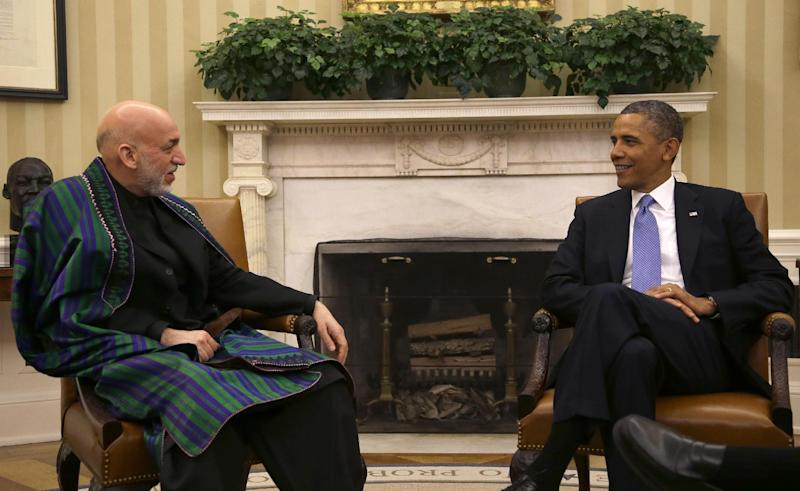 President Barack Obama talks with Afghan President Hamid Karzai during their bilateral meeting in the Oval Office of the White in Washington, Friday, Jan. 11, 2013. (AP Photo/Pablo Martinez Monsivais)