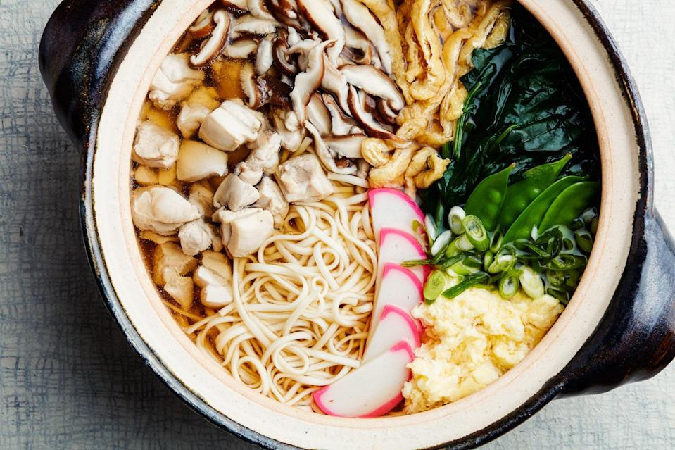 """This classic Japanese soup is both nourishing and comforting—just the thing for those midwinter blues. <a href=""""https://www.epicurious.com/recipes/food/views/nabeyaki-udon-soup-with-chicken-spinach-and-mushrooms?mbid=synd_yahoo_rss"""" rel=""""nofollow noopener"""" target=""""_blank"""" data-ylk=""""slk:See recipe."""" class=""""link rapid-noclick-resp"""">See recipe.</a>"""