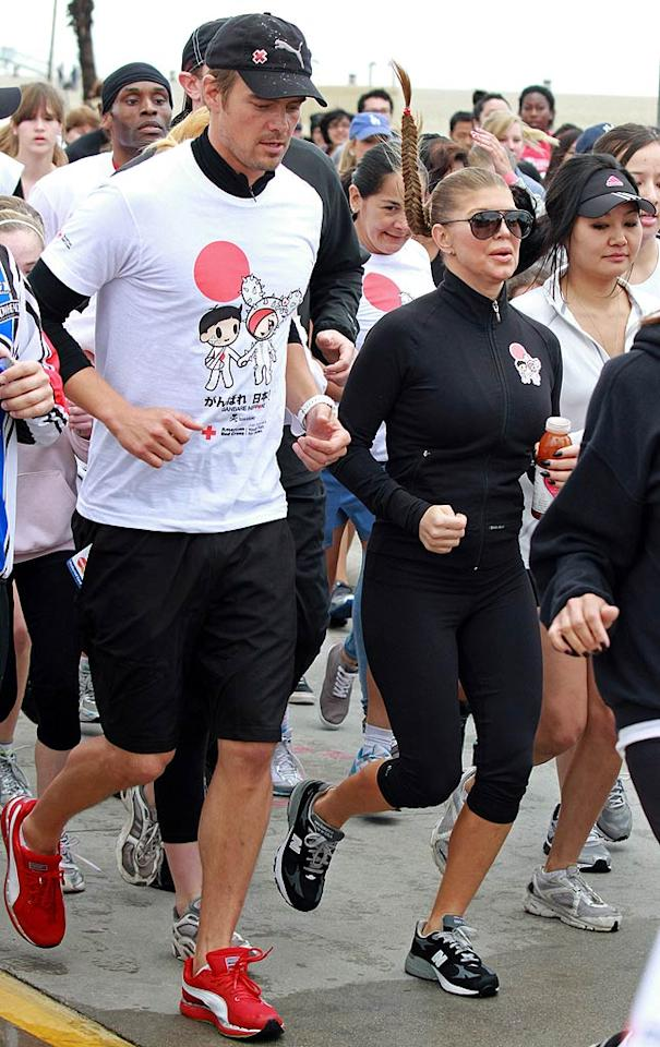 """The """"Transformers"""" star even got his wife out running on her birthday for the cause! Fergie turned 36, which the couple celebrated Friday night at The Bank Nightclub at the Bellagio in Sin City. Jean Baptiste Lacroix/<a href=""""http://www.wireimage.com"""" target=""""new"""">WireImage.com</a> - March 27, 2011"""
