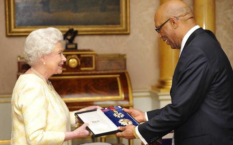 Queen Elizabeth II, knights Governor-General Of Jamaica Sir Patrick Allen on June 12, 2009 - Getty Images Europe