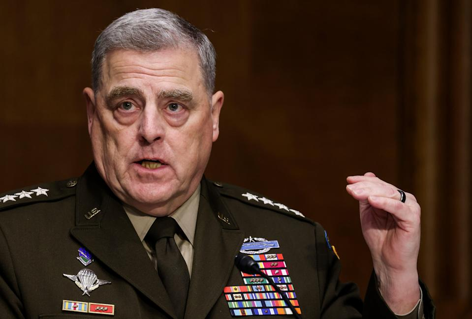 Joint Chiefs of Staff Chair Gen Mark Milley testifies on the Defense Department's budget request during a Senate Appropriations Committee hearing on Capitol Hill on 17 June, 2021 in Washington, DC. Mr Milley repeatedly rebuffed calls from former President Donald Trump and associates for violent military intervention in protests last year, a new book claims. (Getty Images)
