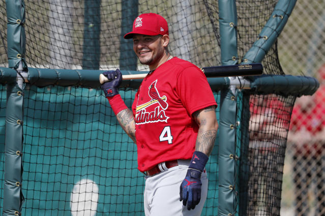St. Louis Cardinals' Yadier Molina smiles as he prepares to step into the batting cage during spring training baseball practice Wednesday, Feb. 12, 2020, in Jupiter, Fla. (AP Photo/Jeff Roberson)