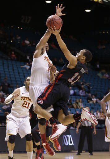 Utah's Brandon Taylor (11) shoots against USC's Jio Fontan in the first half during a Pac-12 tournament NCAA college basketball game on Wednesday, March 13, 2013, in Las Vegas. (AP Photo/Julie Jacobson)