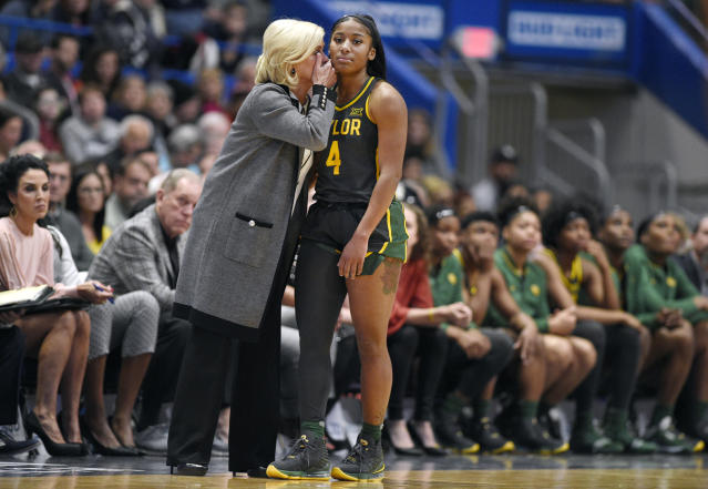 Baylor coach Kim Mulkey, left, talks with Baylor's Te'a Cooper during the second half of the team's NCAA college basketball game against Connecticut, Thursday, Jan. 9, 2020, in Hartford, Conn. (AP Photo/Jessica Hill)