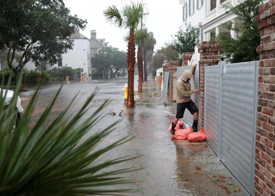 Brys Stephens struggles to install a metal flood gate along South Battery during Hurricane Dorian in Charleston, South Carolina on 5 September 2019.