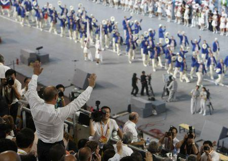Russian Prime Minister Putin waves to Russia's delegation at opening ceremony of Beijing 2008 Olympic Games at National Stadium