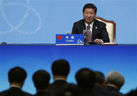 China's President Xi Jinping delivers a speech to the media during the fourth Conference on Interaction and Confidence Building Measures in Asia (CICA) summit, in Shanghai May 21, 2014. REUTERS/Aly Song
