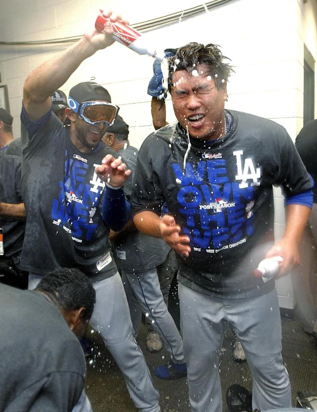 Los Angeles Dodgers' Hyun-Jin Ryu, of South Korea, right, and teammates celebrate after the Dodgers clinched the NL West title with a 7-6 win over the Arizona Diamondbacks in a baseball game, Thursday, Sept. 19, 2013, in Phoenix. (AP Photo/Matt York)