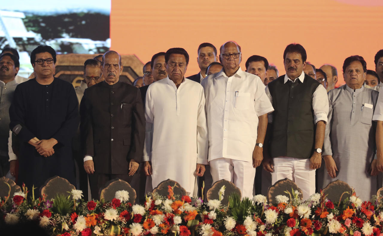 Nationalist Congress Party (NCP) leader Sharad Pawar, third right, stands with other leaders at a swearing-in-ceremony of Shiv Sena party leader Uddhav Thackeray as chief minister of Maharashtra state during a swearing-in-ceremony in Mumbai, Thursday, Nov. 28, 2019. Supporters of the Shiv Sena, Nationalist Congress Party (NCP) and the Congress party thronged Shivaji Park to watch their leaders take oath of office. (AP Photo/Rafiq Maqbool)