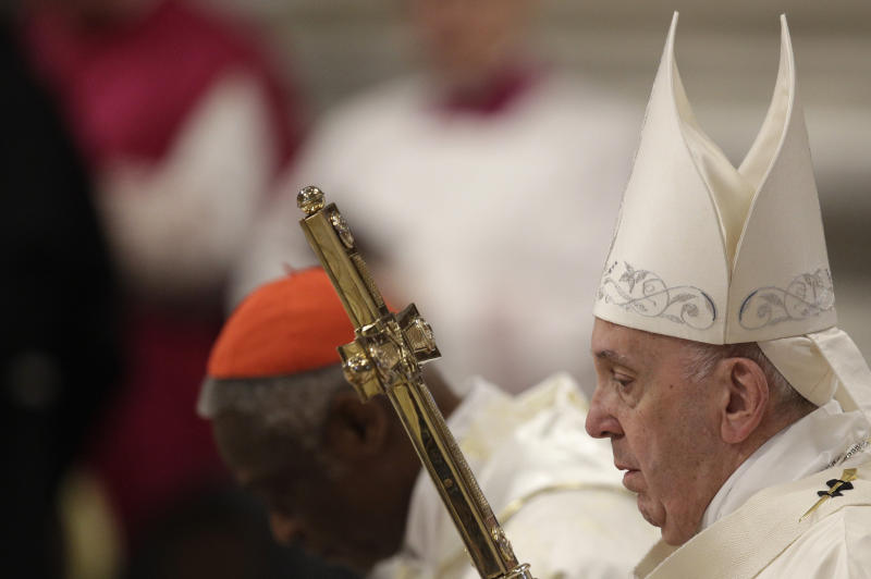 Pope Francis presides over a Mass for the solemnity of St. Mary at the beginning of the new year, in St. Peter's Basilica at the Vatican, Wednesday, Jan. 1, 2020. (AP Photo/Gregorio Borgia)