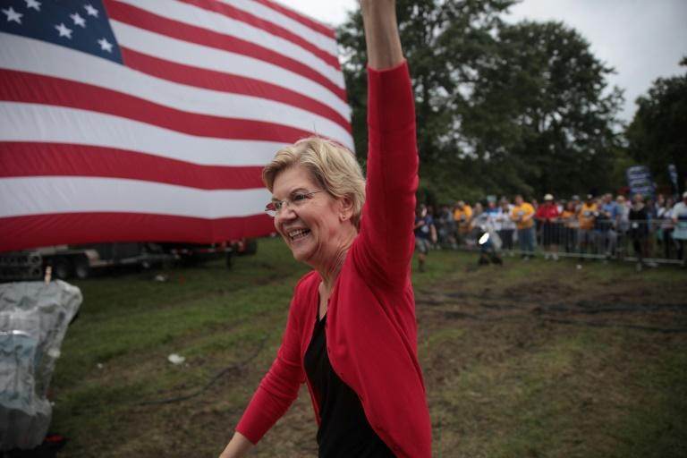 Massachusetts Senator Elizabeth Warren leads former vice president Joe Biden in a new national poll in the race for the 2020 Democratic presidential nomination (AFP Photo/SCOTT OLSON)