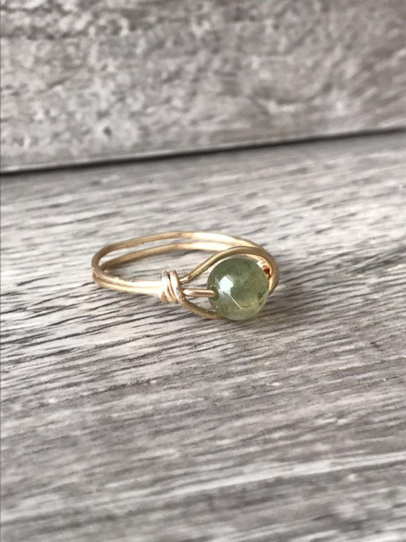 <p>The beautiful <span>Fidget Green Jasper Ring With Gold Band</span> ($22) will offer a sense of calm as you spin along.</p>