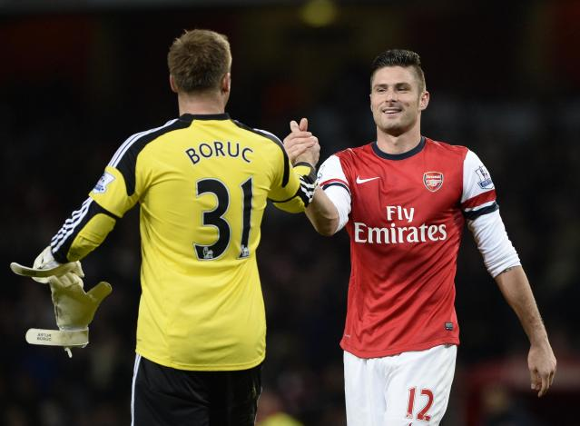 """Arsenal's Olivier Giroud (R) and Southampton's Artur Boruc shake hands at the end of their English Premier League soccer match at the Emirates stadium in London November 23, 2013. REUTERS/Dylan Martinez (BRITAIN - Tags: SPORT SOCCER) FOR EDITORIAL USE ONLY. NOT FOR SALE FOR MARKETING OR ADVERTISING CAMPAIGNS. NO USE WITH UNAUTHORIZED AUDIO, VIDEO, DATA, FIXTURE LISTS, CLUB/LEAGUE LOGOS OR """"LIVE"""" SERVICES. ONLINE IN-MATCH USE LIMITED TO 45 IMAGES, NO VIDEO EMULATION. NO USE IN BETTING, GAMES OR SINGLE CLUB/LEAGUE/PLAYER PUBLICATIONS"""