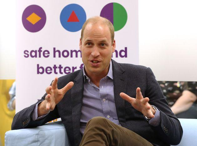 The Duke of Cambridge speaks to former and current service users during a visit to the Albert Kennedy Trust in London to learn about the issue of LGBTQ youth homelessness in London on June 26.