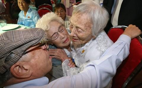 <span>South Koreans Jo Hye-do, 86, and Jo Do-jae, 75, meet their North Korean sister Jo Soon Do, 89</span> <span>Credit: AFP/AFP </span>