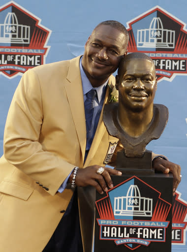 Hall of Fame Inductee Derrick Brooks poses with his bust during the 2014 Pro Football Hall of Fame Enshrinement Ceremony at the Pro Football Hall of Fame Saturday, Aug. 2, 2014, in Canton, Ohio. (AP Photo/Tony Dejak)