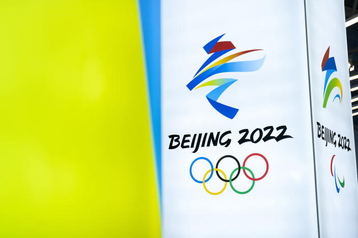 """FILE - In this Feb. 5, 2021, file photo, the logos for the 2022 Beijing Winter Olympics and Paralympics are seen during an exhibit at a visitors center at the Winter Olympic venues in Yanqing on the outskirts of Beijing. Groups alleging human-rights abuses in China are calling for a full boycott of the Beijing Olympics, which is sure to ratchet up pressure on the International Olympic Committee, athletes, sponsors, and sports federations. A coalition of activists representing Uyghurs, Tibetans, residents of Hong Kong and others, issued a statement Monday, May 17, 2021 calling for the """"full boycott,"""" eschewing lesser measures like """"diplomatic boycotts"""" and negotiations with the IOC or China. (AP Photo/Mark Schiefelbein, File)"""