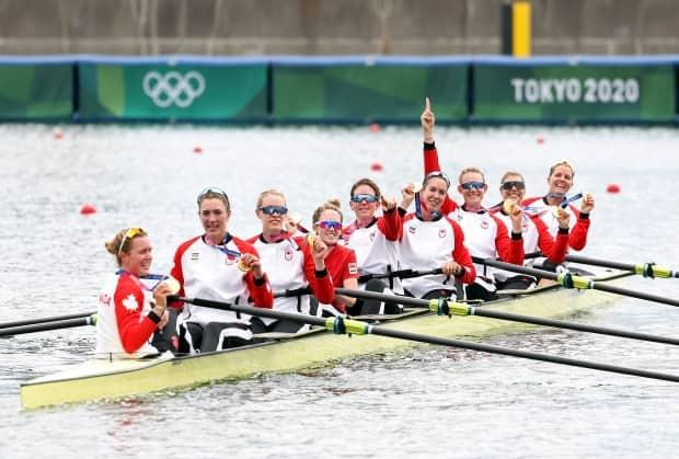 The Canadian women's eight rowing crew poses with their gold medals during the Tokyo Olympics. (Leon Neal/Getty Images - image credit)