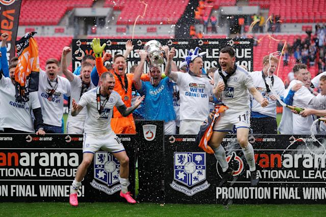 Soccer Football - National League Promotion Final - Tranmere Rovers v Boreham Wood - Wembley Stadium, London, Britain - May 12, 2018 Tranmere Rovers celebrate with the trophy after winning the National League Play Off Final Action Images/Andrew Couldridge