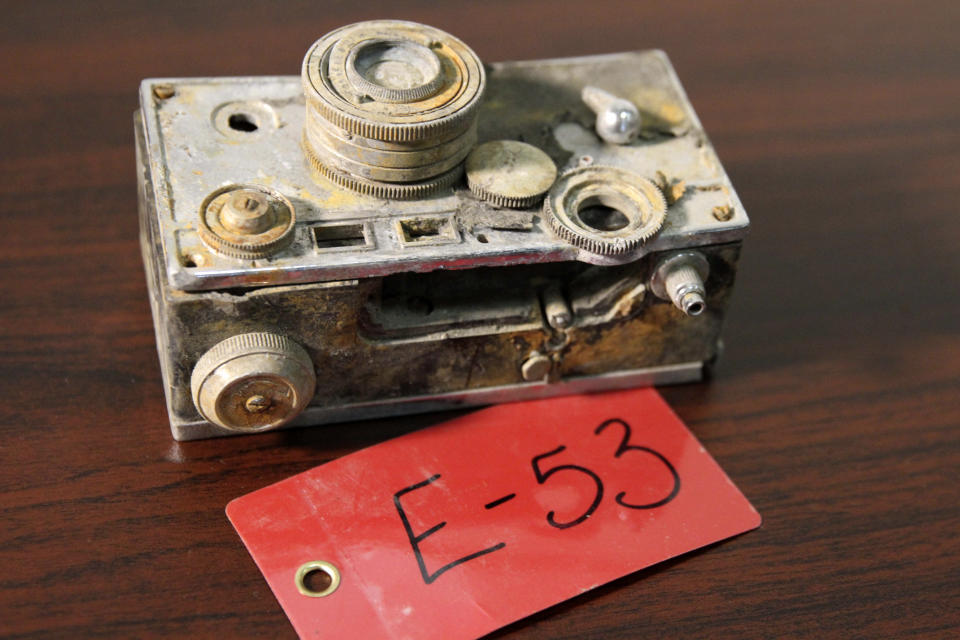 A camera recovered from the 1952 crash of a C-124 Globemaster was found this month on Colony Glacier and displayed at Joint Base Elmendorf-Richardson, Alaska, Tuesday, Sept. 29, 2021. The plane slammed into a mountain, killing 52 on board, and the plane and its crew have since become part of the glacier. The military has conducted annual summer recovery efforts, finding human remains and personal items on the glacier. (AP Photo/Mark Thiessen)