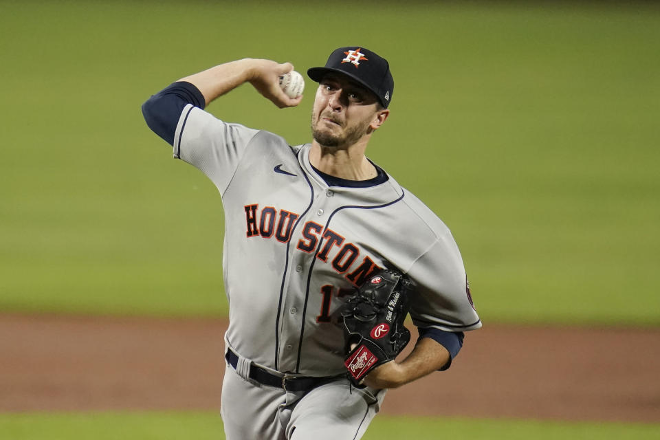 Houston Astros starting pitcher Jake Odorizzi throws a pitch to the Baltimore Orioles during the first inning of a baseball game, Monday, June 21, 2021, in Baltimore. (AP Photo/Julio Cortez)